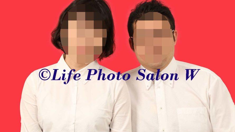 赤背景の中国結婚証用の証明写真撮影